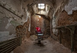 Barber chair in an abandoned prison cell