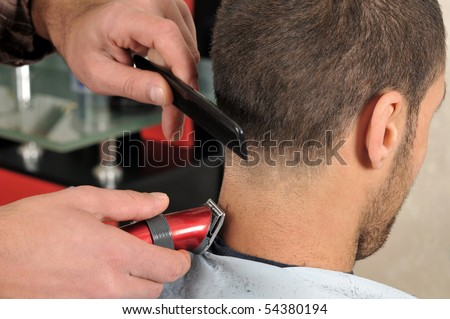 Barber cutting hair with clipper