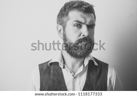 Barber fashion and beauty. Fashion model with stylish hair isolated on white. Man with long beard and mustache on serious face. Guy or bearded businessman. Hipster in shirt and waistcoat. #1118177333