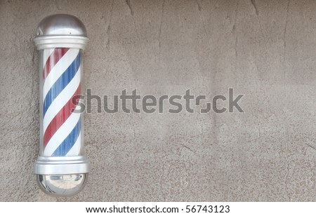 Barber pole on stone wall