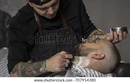 barber preparing to shave the beard in the barbershop.Close up image #707954380