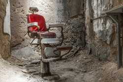 Barber's chair in a cell in an abandoned prison