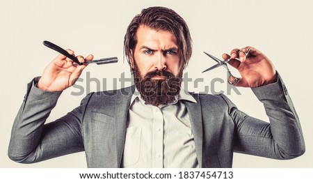 Barber scissors and straight razor, barber shop, suit. Vintage barber shop, shaving. Bearded client visiting barber shop. Portrait bearded man. Vintage barbershop. Photo stock ©