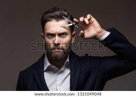 Barber scissors, barber shop. Brutal male, hipster with moustache. Male in barbershop, haircut, shaving. Bearded man, bearded male. Mans haircut in barber shop #1321049048