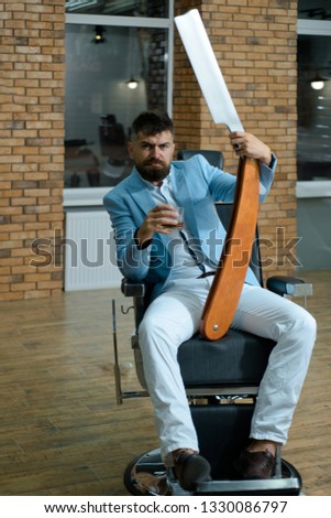 Barber shop and barber vintage. Making haircut look perfect in barber shop. Barber making haircut of attractive bearded man in barbershop