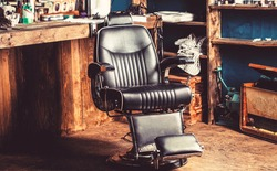 Barber shop chair. Barbershop armchair, modern hairdresser and hair salon, barber shop for men. Stylish vintage barber chair. Professional hairstylist in barbershop interior.