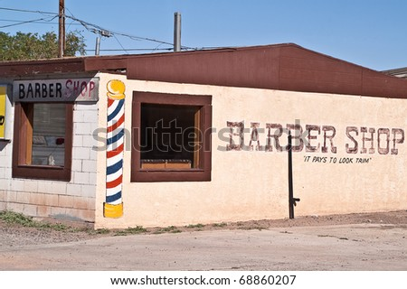 Barber shop on Route 66 with painted barber pole on side of building