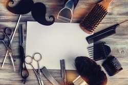 Barber shop tools on old wooden background with copy space
