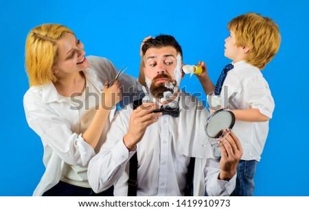 Barbershop. Barber shop tools. Hairdresser making hairstyle. Beard care. Hair preparation. Fashion. Bearded man in barbershop. Coiffeur making hairstyle. Scissors. #1419910973