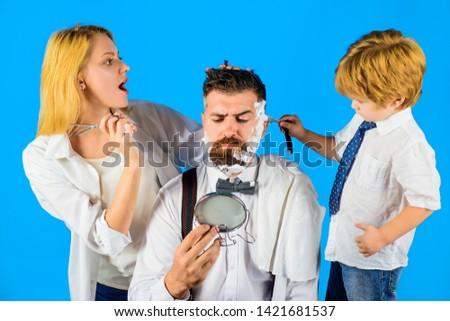 Barbershop. Barber shop tools. Hairdresser making hairstyle. Beard care. Hair preparation. Fashion. Bearded man in barbershop. Razor blade.