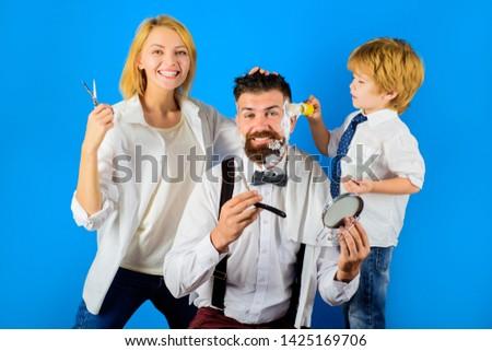 Barbershop. Bearded man. Barber shop tools. Beard care. Bearded man in barbershop. Hipster. Foam for shaving. Barber scissors and razor.