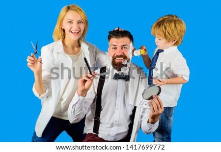 Barbershop. Bearded man. Barber shop tools. Hairdresser making hairstyle. Beard care. Hair preparation. Bearded man in barbershop. Foam for shaving. Barber scissors and razor. Hipster.