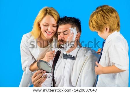 Barbershop. Bearded man. Barber tools. Hairdresser making hairstyle. Beard care. Hair preparation. Bearded man in barbershop. Hipster. Foam for shaving. Barber scissors and razor.