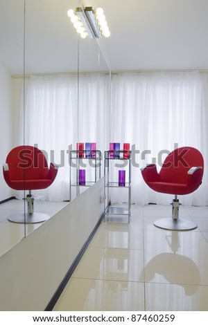 Barbershop interior with red chair