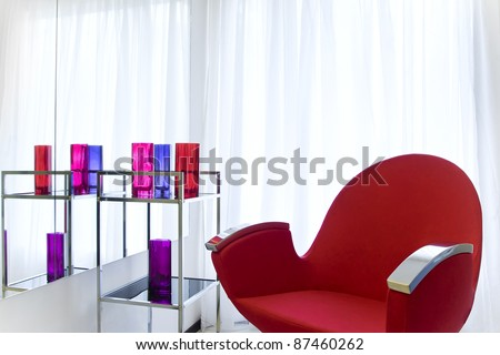 Barbershop interior with red chair close up