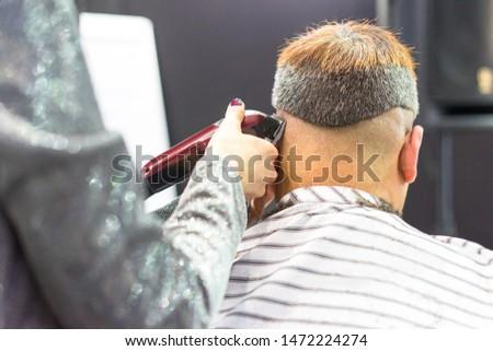 Barbershop. Men's haircut machine. Hairdresser cuts a man. Hairdressing equipment. Beauty salon for men. Hair clipper.