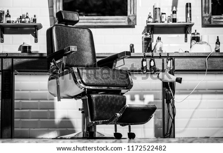 Barbershop theme. Hairstylist in barber shop interior. Barber shop chair. Stylish vintage barber chair. Barbershop armchair, modern hairdresser and hair salon, barber shop for men. Black and white.