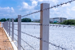 barbwire  fence in factory area