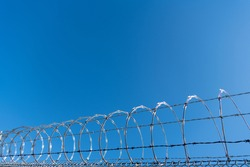barbwire prison wall with barbed wire fence coiled razor wire perimeter fence, barbwire.