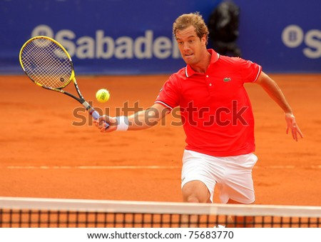 BARCELONA - APRIL 19: French tennis player Richard Gasquet in action during the first round match of the Barcelona tennis tournament Conde de Godo on April 19, 2011 in Barcelona