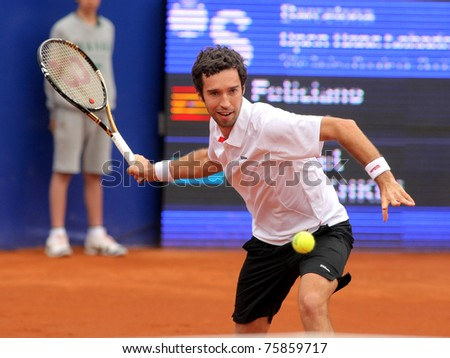 BARCELONA - APRIL 19: Kazakh tennis player Mikhail Kukushkin in action during his match against Feliciano Lopez of Barcelona tennis tournament Conde de Godo on April 19, 2011 in Barcelona, Spain