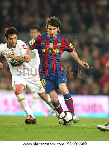 BARCELONA-APRIL 14: Leo Messi of Barcelona in action during a Spanish League match between FC Barcelona and RC Deportivo at the Nou Camp Stadium on April 14, 2010 in Barcelona, Spain - stock photo