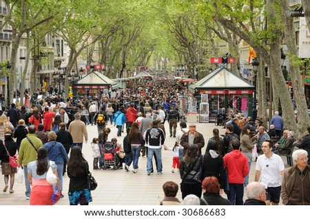 BARCELONA - APRIL 16: People walk by at the famous La Rambla  April 16, 2009 in Barcelona, Spain. - stock photo