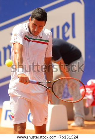 BARCELONA - APRIL 21: Romanian tennis player Victor Hanescu in action during his match against David Ferrer  of Barcelona tennis tournament Conde de Godo on April 21, 2011 in Barcelona