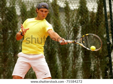 BARCELONA - APRIL 19: Spanish tennis player Rafa Nadal training the day before of his debut during the Barcelona tennis tournament Conde de Godo on April 19, 2011 in Barcelona