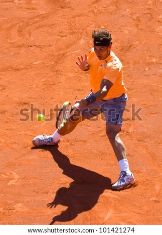 BARCELONA - APRIL 29: Spanish tennis player Rafael Nadal in action during his final match against David Ferrer at Barcelona tennis tournament Conde de Godo on April 29, 2012, in Barcelona, Spain.