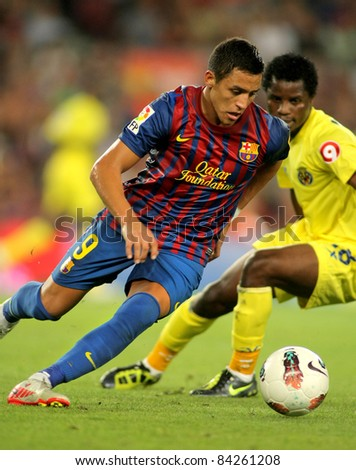 BARCELONA AUG 29 Alexis Sanchez of FC Barcelona in action during a Spanish League match between FC Barcelona and Villarreal at the Nou Camp Stadium on August 29 2011 in Barcelona Spain