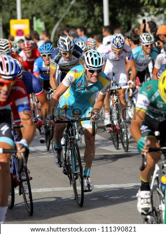 BARCELONA - AUG, 26: Astana Belgian cyclist Kevin Seeldraeyers rides with the pack during the Vuelta Ciclista a Espana cycling race in Barcelona on August 26, 2012 - stock photo