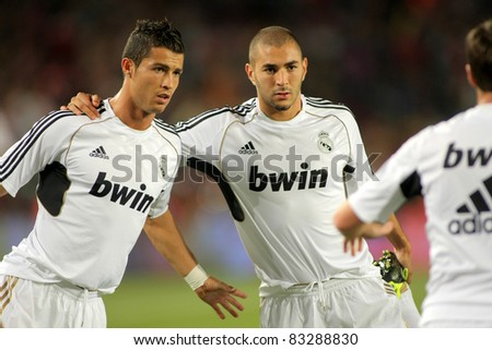 BARCELONA - AUG 17: Cristiano Ronaldo(L) and Benzema(R) of Madrid stretching before the Spanish Supercup football match against Barcelona at the New Camp Stadium in Barcelona, Spain on August 17, 2011