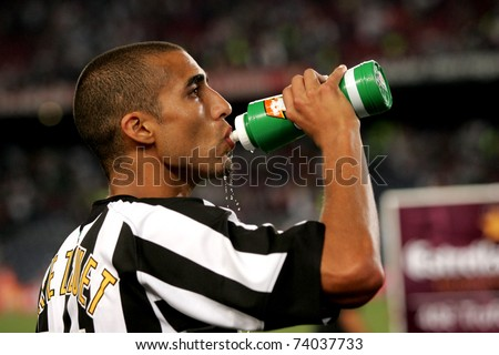 BARCELONA - AUG 24: French player David Trezeguet of Juventus refreshing during the friendly match between Barcelona and Juventus at Nou Camp Stadium August 24, 2005 in Barcelona, Spain