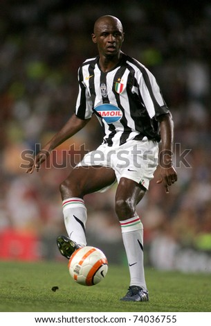BARCELONA - AUG 24: French player Patrick Vieria of Juventus in action during the friendly match between Barcelona and Juventus at Nou Camp Stadium August 24, 2005 in Barcelona, Spain