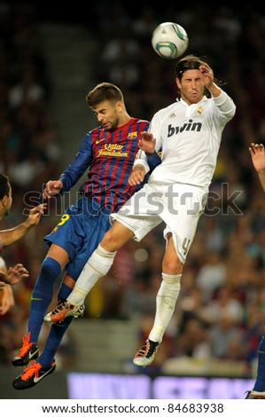 BARCELONA AUG 17 Gerard Pique L of FC Barcelona vies with Sergio Ramos R of Real Madrid during the Spanish Supercup football match at the New Camp Stadium in Barcelona on August 17 2011