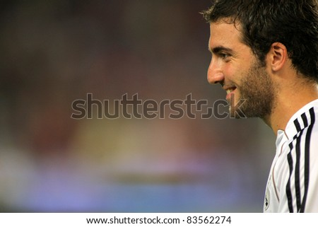 BARCELONA - AUG 17: Gonzalo Higuain of Real Madrid before the Spanish Supercup football match against FC Barcelona at the New Camp Stadium on August 17, 2011 in Barcelona, Spain