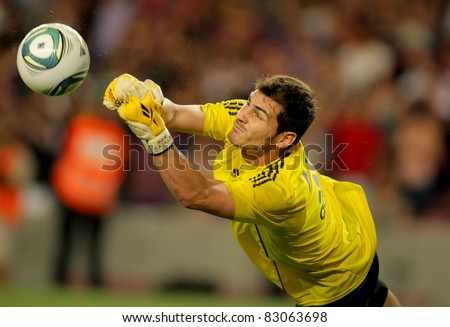 BARCELONA - AUG 17: Iker Casillas of Real Madrid throws the ball  during the Spanish Supercup football match between Barcelona vs Real Madrid at the New Camp Stadium in Barcelona, Spain on August 17, 2011