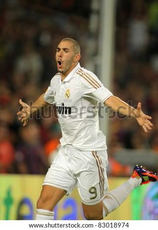 BARCELONA - AUG 17: Karim Benzema of Real Madrid celebrating goal during the Spanish Supercup football match between Barcelona vs Real Madrid at the New Camp Stadium in Barcelona, on August 17, 2011