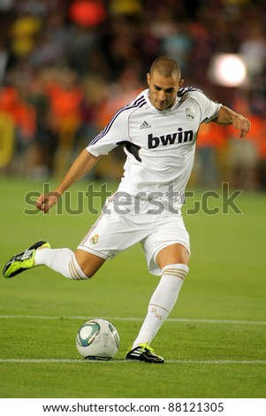 BARCELONA - AUG 17: Karim Benzema of Real Madrid in action during the Spanish Supercup football match against FC Barcelona at the New Camp Stadium on August 17, 2011 in Barcelona, Spain - stock photo