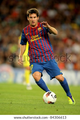 BARCELONA AUG 29 Leo Messi of FC Barcelona in action during a Spanish League match between FC Barcelona and Villarreal at the Nou Camp Stadium on August 29 2011 in Barcelona Spain