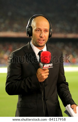 BARCELONA - AUG 17: Martin Ainstein of ESPN reports before the Spanish Supercup football match against FC Barcelona at the New Camp Stadium on August 17, 2011 in Barcelona, Spain