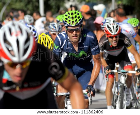 BARCELONA - AUG, 26: Movistar Team spanish cyclist Jose Joaquin Rojas rides with the pack during the Vuelta Ciclista a Espana cycling race in Barcelona on August 26, 2012