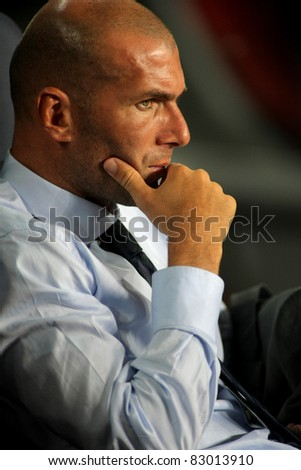 BARCELONA - AUG 17: Real Madrid Sporting Diretor Zinedine Zidane, during Spanish Supercup football match between Barcelona vs Real Madrid at the New Camp Stadium in Barcelona, on August 17, 2011