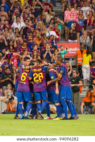 BARCELONA - AUGUST 22: Barcelona players celebrates a goal during the Gamper Trophy final match between FC Barcelona and Napoli, final score 5 - 0, on August 22, 2011 in Camp Nou, Barcelona, Spain.