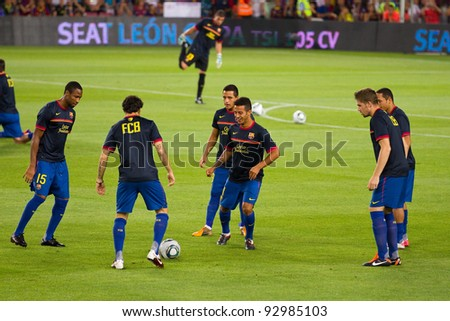 BARCELONA - AUGUST 17: Barcelona players warm-up before the Spanish Super Cup final match between FC Barcelona and Real Madrid, 3 - 2, on August 17, 2011 in Camp Nou stadium, Barcelona, Spain.