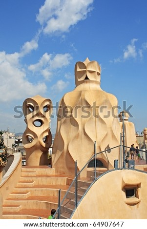 BARCELONA - AUGUST 31: Casa Mila La Pedrera building roof and chimneys on August 31, 2010 in Barcelona. Casa Mila is one of buildings created by famous Antonio Gaudi.
