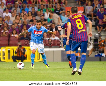 BARCELONA - AUGUST 22: Ezequiel Lavezzi (L) in action during the Gamper Trophy final match between FC Barcelona and Napoli, final score 5 - 0, on August 22, 2011 in Camp Nou stadium, Barcelona, Spain.