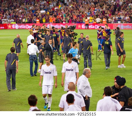 BARCELONA - AUGUST 17: FC Barcelona players celebrate Spanish Super Cup victory after beating Real Madrid (3 - 2) on August 17, 2011 in Camp Nou, Barcelona, Spain.