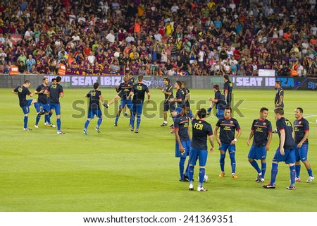 BARCELONA - AUGUST 17: FCB players in action at the Spanish Super Cup final match between FC Barcelona and Real Madrid, 3 - 2, on August 17, 2011 in Camp Nou stadium, Barcelona, Spain.